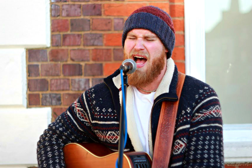 Musician Tom Dibb playing an acoustic set of his album Sun Child in Leighton Buzzard. Photograph by 4toconvert